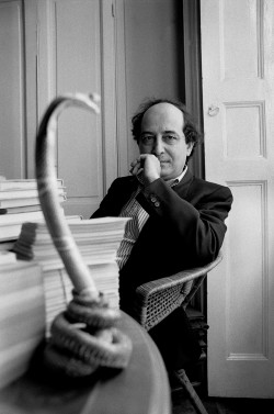 Roberto Calasso in his house in Milan with a sculpture of an Indian snake, 1989