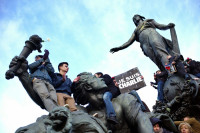 Demonstrators on the Triumph of the Republic statue at Place de la Nation, during the march in support of Charlie Hebdo, Paris, January 11, 2015