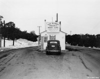 Los Alamos main gate, opened April 20, 1943 when the University of California signed a contract with the United States Army Corps of Engineers to operate a secret laboratory in the mountains of northern New Mexico