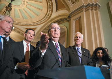 Senate Majority Leader Mitch McConnell with, from left, Republican Senators Roger Wicker and John Barrasso and Senate Majority Whip John Cornyn at the Capitol, January 2015