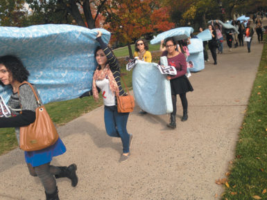 Rutgers students and faculty marching in solidarity with survivors of sexual assault in the 'Help Carry the Weight' campaign, New Brunswick, New Jersey, October 2014. This march and others around the country were inspired by Emma Sulkowicz, a senior at Columbia who alleges she was raped by a fellow student and has been carrying a mattress on campus every day to protest the university's handling of her case.