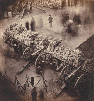 A barricade of the Communards at the corner of the Rue de Rivoli and the Place de l'Hôtel de Ville, Paris, April 1871