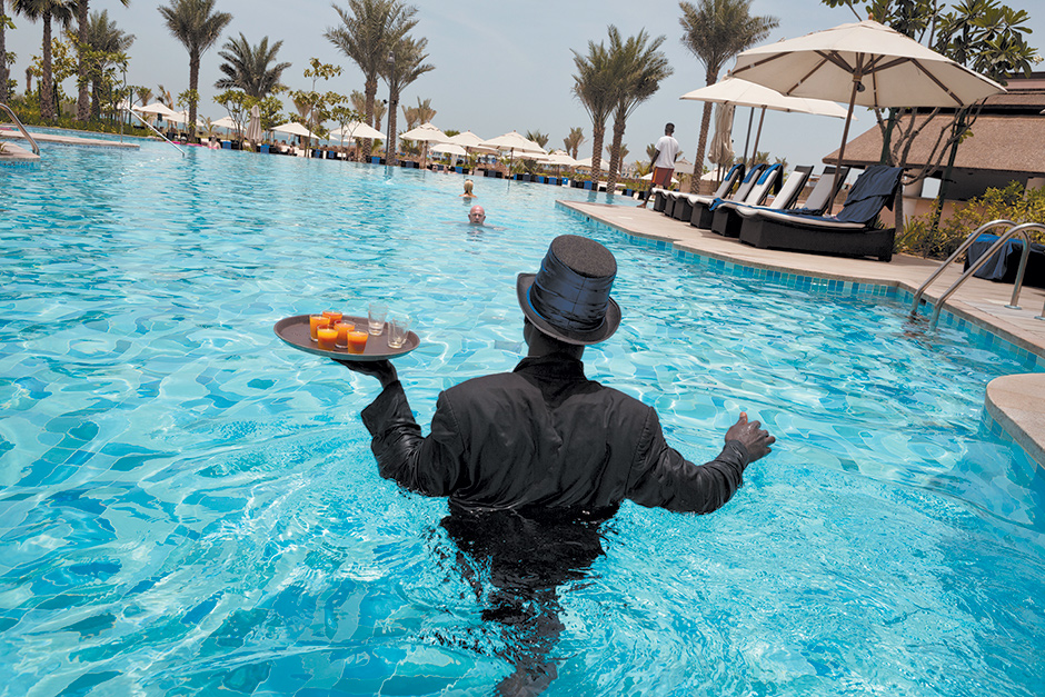 A 'pool ambassador' serving drinks in the pool at the Ritz-Carlton hotel, Dubai, 2013
