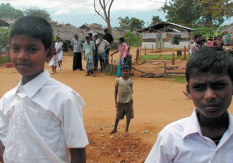 Tamil boys at a refugee camp on the outskirts of the northern Sri Lankan town of Vavuniya during a visit by UN Secretary-General Ban Ki-moon, May 2009