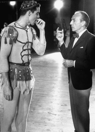 George Balanchine with ballet dancer Jacques d'Amboise on the set of A Midsummer Night's Dream, circa 1963