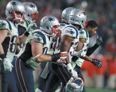 New England Patriots cornerback Malcolm Butler (without helmet) leading his team off the field after his game-saving interception against the Seattle Seahawks in the Super Bowl, February 1, 2015