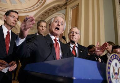 Senator Bob Corker, outlining his proposal for a congressional vote on a nuclear deal with Iran, with Senate Majority Leader Mitch McConnell, right, Washington, March 3, 2015