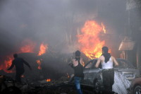 The aftermath of a car bomb in Homs, Syria, April 9, 2014