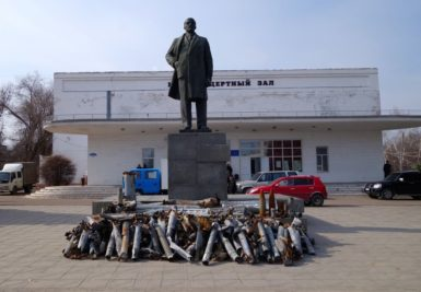 Missile casings and unexploded shells in front of a statue of Lenin, Pervomaysk, Ukraine, March 20, 2015