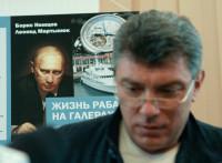 Slain Russian opposition leader Boris Nemtsov, presenting an investigation of Putin's lavish lifestyle, Moscow, August 28, 2012