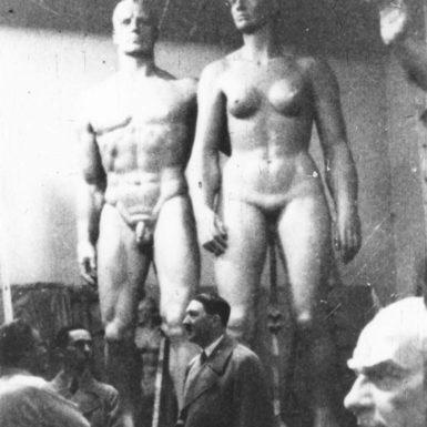 Adolf Hitler in the workshop of the sculptor Josef Thorak, with Thorak's bust of Atatürk behind him, Munich, February 1937