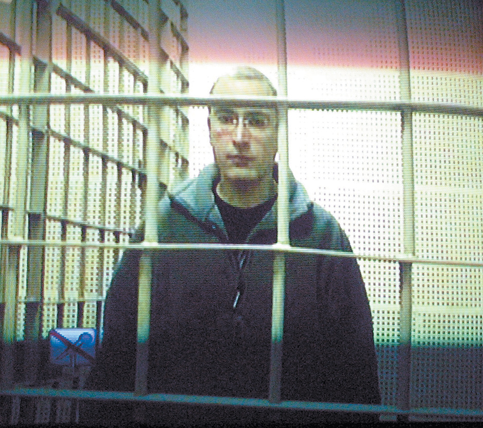 Mikhail Khodorkovsky appearing on a TV screen installed inside a courtroom, Moscow, January 2004
