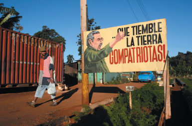 A sign showing Cuban President Raúl Castro, and saying 'May the earth tremble, compatriots!,' Havana, Cuba, December 2014