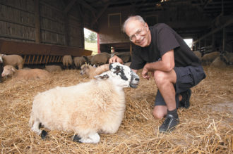 Peter Singer at Farm Sanctuary, a shelter for rescued farm animals, Watkins Glen, New York, 2006