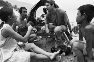 Peter Hessler with the Huangs, a local fishing family described in his 2003 New Yorker essay 'Underwater,' on the rising waters of the Yangtze River shortly after the gates of the Three Gorges Dam were closed, Wushan, China, June 2003