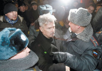 Policemen detaining Eduard Limonov at an unauthorized opposition rally in central Moscow, December 2009