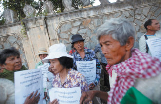 Victims of the Khmer Rouge regime protesting outside the Extraordinary Chambers in the Courts of Cambodia to demand individual reparations, Phnom Penh, October 2014