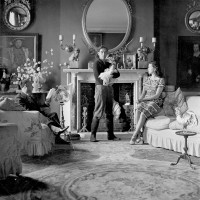 Lord Berners, Robert Heber-Percy with his daughter Victoria, and Jennifer Fry in the drawing room at Faringdon, Berkshire, September 1943; photograph by Cecil Beaton