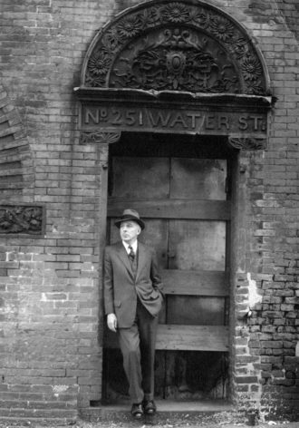 Joseph Mitchell in Lower Manhattan, near the old Fulton Fish Market; photograph by his wife, Therese Mitchell