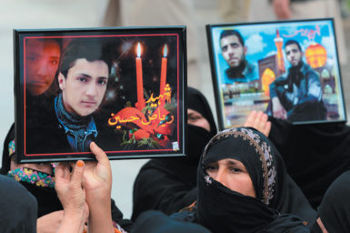 Pakistani Shiite Muslims protesting a suicide bomb attack on a Shiite mosque in Peshawar with portraits of the victims, February 20, 2015. At least twenty-three people were killed in the attack on February 13, for which the Taliban claimed responsibility.