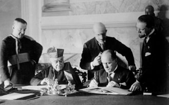 Monsignor Francesco Borgongini-Duca, Cardinal Pietro Gasparri, Francesco Pacelli, Benito Mussolini, and Dino Grandi at the signing of the Lateran Treaty between Italy and the Vatican, February 1929