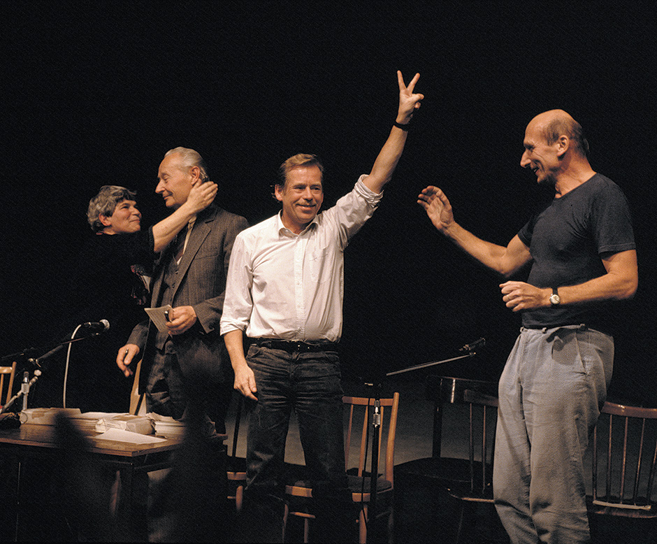 Václav Havel (center) at the Laterna Magika theater, Prague, on November 24, 1989, the day that the Communist Party's leadership resigned. He is with, from left to right, Rita Klímová, who became the first post-Communist ambassador to the US; Alexander Dubček, who had been the Czechoslovak premier during the Prague Spring; and the music critic and broadcaster Jiří Černy, an important member of the Civic Forum's coordinating committee.