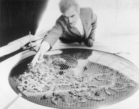 Frei Otto with his model of an arctic city under an air conditioned container structure, 1971