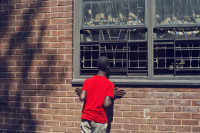 A boy looking into the Louis H. Pink housing project, Brooklyn, New York, 2012
