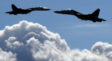 Russian Sukhoi Su-27 jet fighters perform during an air show in St. Petersburg, Russia, April 25, 2015