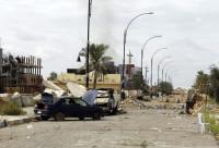 Debris on a road in Tikrit, April 1, 2015