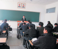 Suki Kim teaching a class at Pyongyang University of Science and Technology, North Korea, 2011