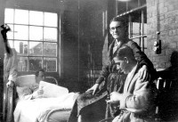 C.K. Scott Moncrieff (in spectacles), who was wounded in World War I, at the Ducane Road specialist leg hospital, London, 1917