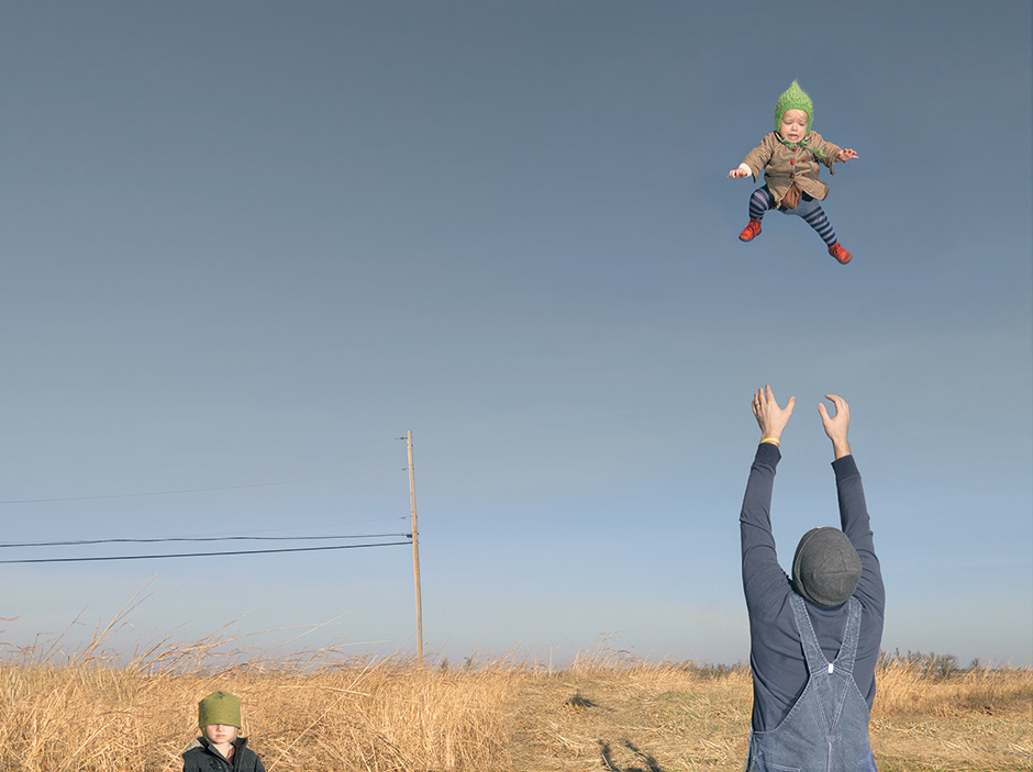 'Baby Toss,' 2009; photograph by Julie Blackmon from her book Homegrown. It includes an introduction by Billy Collins and an interview with Reese Witherspoon, and is published by Radius Books.