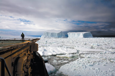John Palmer, the resident doctor onboard the icebreaker Kapitan Khlebnikov, watching two icebergs about to collide in the Ross Sea off Franklin Island, Antarctica, December 2006; photograph by Camille Seaman from her book Melting Away: A Ten-Year Journey Through Our Endangered Polar Regions, just published by Princeton Architectural Press