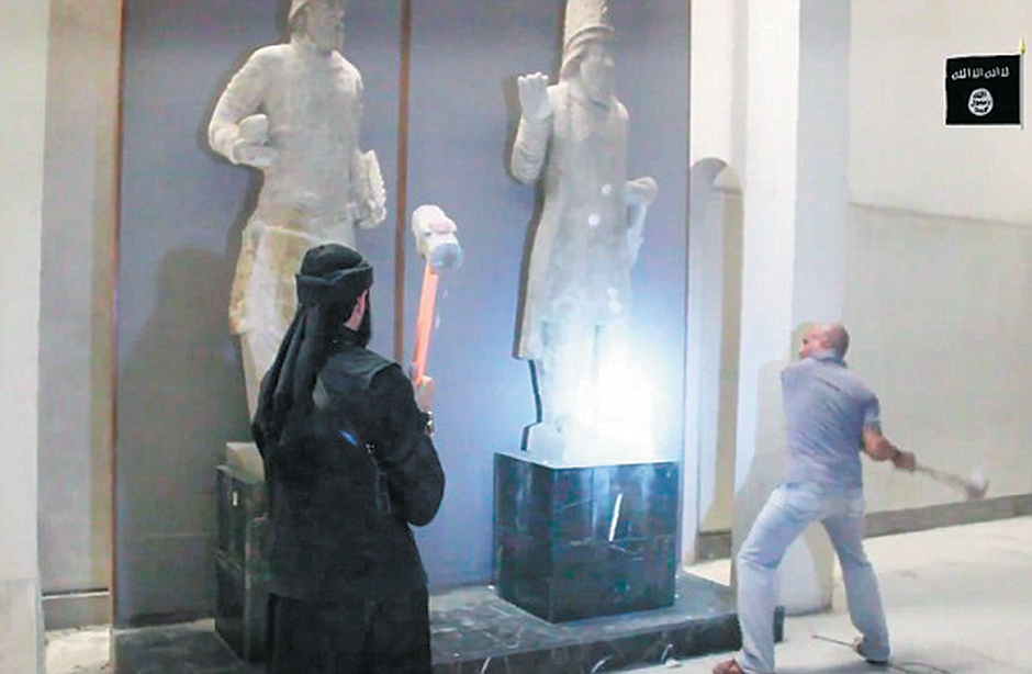 A screen shot of a video released by ISIS showing militants destroying antiquities in the Mosul Museum in Iraq, February 2015