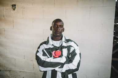 Chris Gage, an inmate at Louisiana State Penitentiary—where a majority of inmates are serving life sentences without parole, many of them for nonviolent crimes—and three-time winner of the 'guts and glory' event at the semiannual Angola Prison Rodeo, in which prisoners try to grab a red poker chip that has been tied to the head of a bull, October 2014. Proceeds from the rodeo go to the Inmate Welfare Fund, which provides for educational and recreational supplies within the prison.