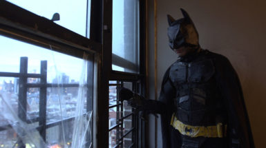 One of the Angulo brothers in a home-made Batman costume, in Crystal Moselle's The Wolfpack, 2015