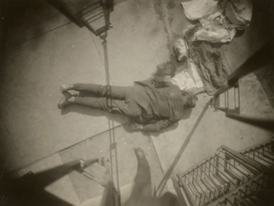 A dead body in front of a church on 86th Street, Queens, May 13, 1926