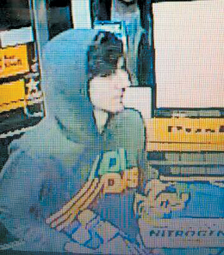 A surveillance photo released by the Boston Police Department during its search for the Tsarnaev brothers, showing Dzhokhar Tsarnaev in a gas station while fleeing the police, Cambridge, Massachusetts, April 18, 2013
