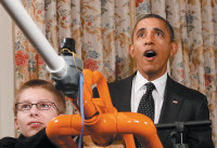 President Obama with teenage inventor Joe Hudy of Arizona during a demonstration of Hudy's Extreme Marshmallow Cannon at the White House Science Fair, February 2012