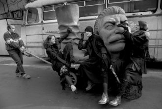 A fashion shoot on a dismantled statue of Stalin, Budapest, 1990