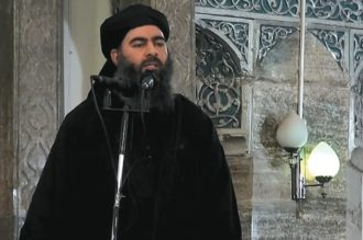 ISIS leader Abu Bakr al-Baghdadi preaching in a mosque in Mosul, from a video released in July 2014