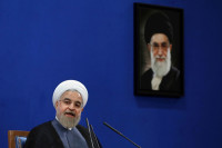 Iranian President Hassan Rouhani, with a picture of Supreme Leader Ali Khamenei, Tehran,  June 13, 2015