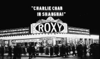 Moviegoers gather at the entrance to the Roxy Theatre in New York, 1935