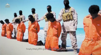 A still from a video released by ISIS on April 19, which appears to show the execution of Ethiopian Christians by members of Wilayat Barqa, an affiliate of ISIS in eastern Libya