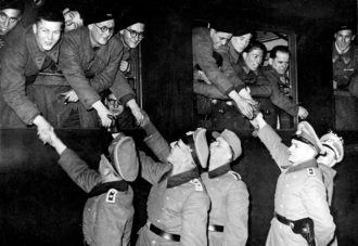 German soldiers shaking hands with French volunteers bound for the front, July 1944