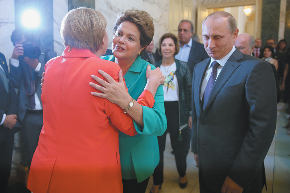 Brazilian President Dilma Rousseff with German Chancellor Angela Merkel and Russian President Vladimir Putin before the final match of the FIFA World Cup, Rio de Janeiro, July 2014