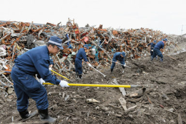 Police searching for victims' remains at the site of Namie Elementary School, Fukushima, Japan, June 11, 2014