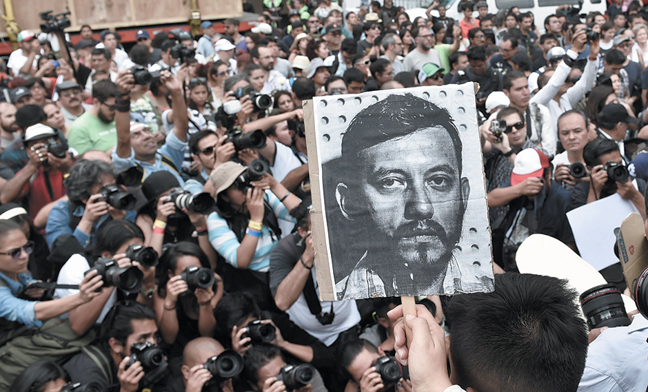 Mexican photojournalists with a picture of their murdered colleague, Rubén Espinosa, at a demonstration in Mexico City, August 2015