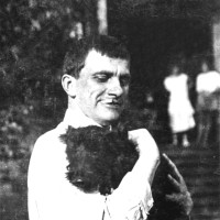Vladimir Mayakovsky with Scotty, a dog bought by Lili Brik in England, at the Briks' dacha in Pushkino, summer 1924